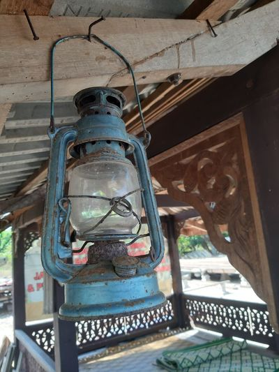 Low angle view of lantern hanging on ceiling