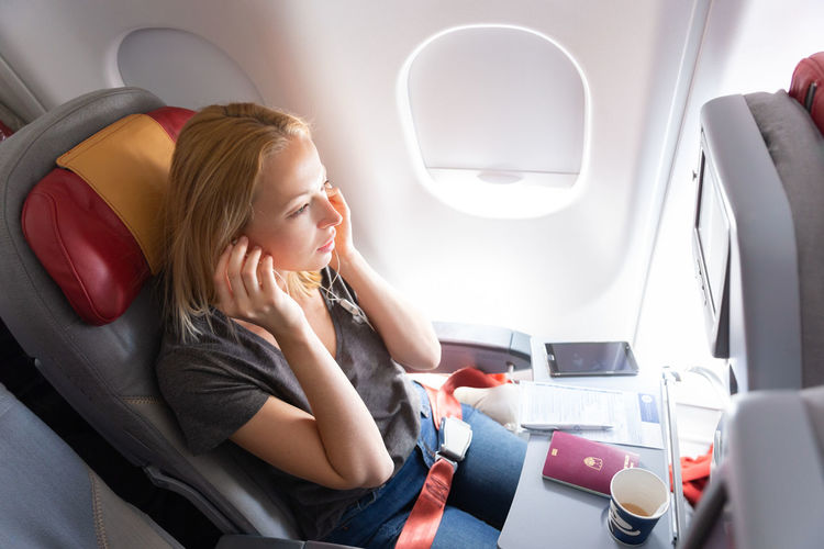 High angle view of businesswoman sitting in plane