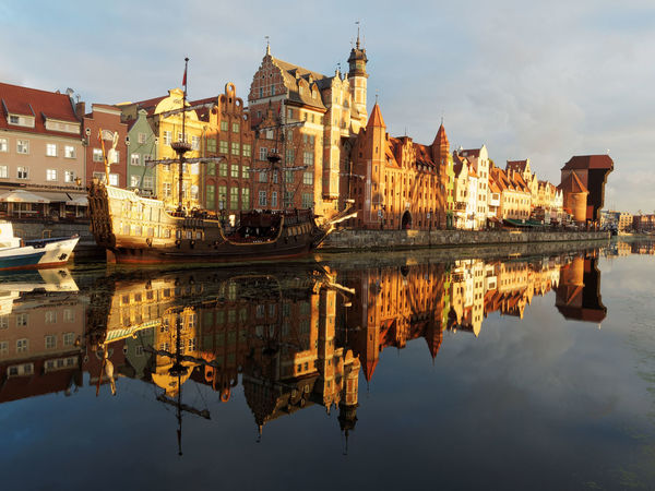 Reflection Sky Architecture Travel Destinations City Water Symmetry Building Exterior History Outdoors Built Structure No People Reflection Lake Sunset Cloud - Sky Day Gdansk (Danzig) Zörk