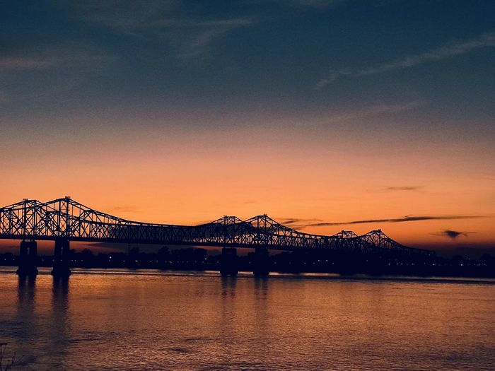 Bridge over river during sunset