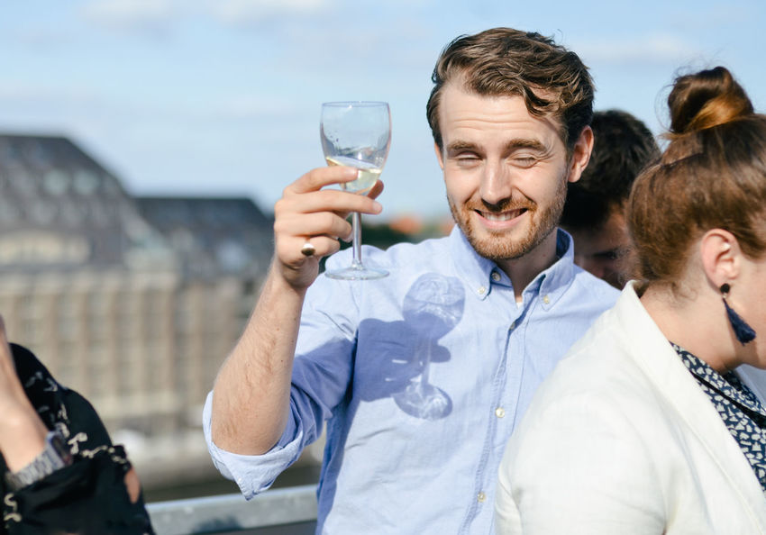 Afterwork Afterwork Beer Rooftop Alcohol Businessman Businesswoman Drink Drinking Glass Happiness Joy Portrait Positive Emotion Real People Refreshment Rooftop Bar Smiling Success Togetherness Wine Young Adult