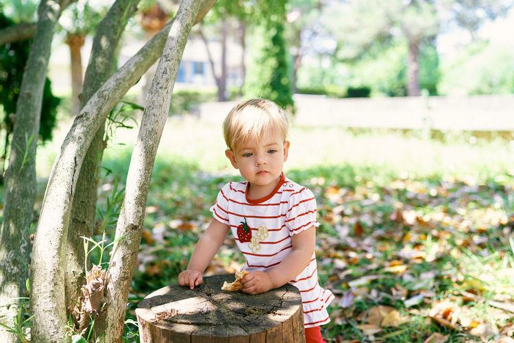 Cute boy looking away outdoors