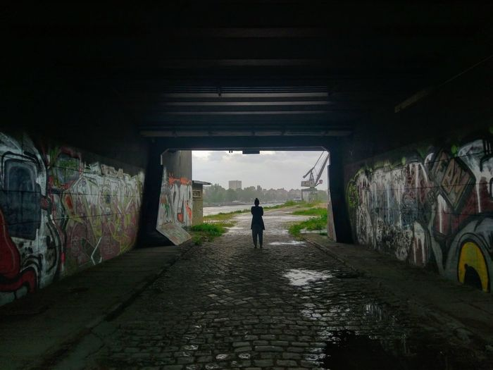 Crane Rainy Days Contemplating Wet Bad Weather Hiding From Rain Urban Spandau Berlin Berlin Photography Bridge - Man Made Structure Full Length City Tunnel Street Art Graffiti Architecture Built Structure Rainy Season Rain RainDrop Rainfall Underpass Spray Paint #FREIHEITBERLIN #FREIHEITBERLIN The Street Photographer - 2018 EyeEm Awards EyeEmNewHere