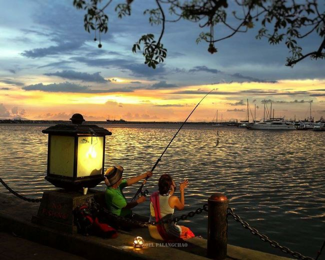 Birds of a feather. Sunset Outdoors Bonding Priceless Moment  People Fishing Time Sea Vessels
