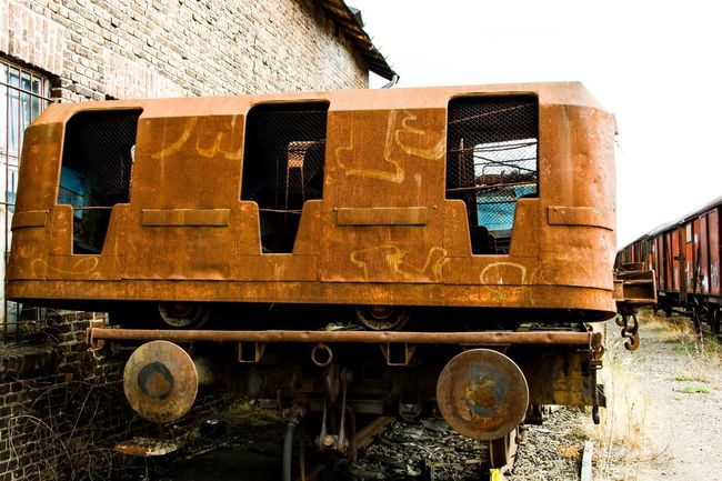 Old Train EyeEm Gallery EyeEm Selects EyeEm Best Shots Train No People Day Nature Built Structure Architecture Old Building Exterior Building Land Vehicle Rail Transportation Metal Sunlight Mode Of Transportation Outdoors Train - Vehicle Transportation Abandoned Train Sky Damaged