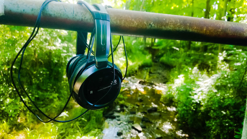 I saw headphones just sitting like this over a creek! Lucky find! Hanging Close-up Water Day Outdoors Technology Meets Nature Nature