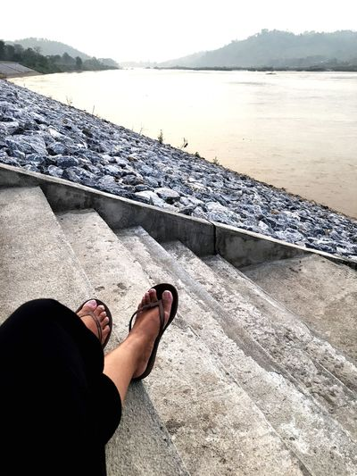 Relaxing sit on the step near Khong River. Chill EyeEm Selects Low Section Human Leg Sand Human Foot barefoot Water Human Body Part Vacations Relaxation