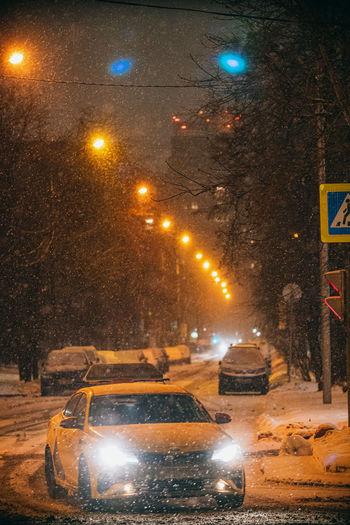 Illuminated street at night during winter