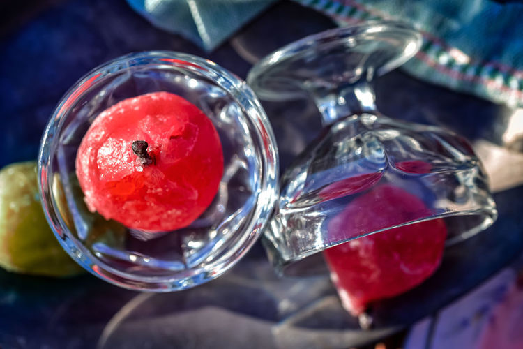 High angle view of fruits in glass on table