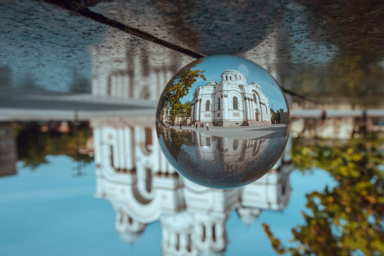 Kaunas through a glass ball Glass Ball Lietuva Lithuania Architecture Building Exterior Built Structure Church Architecture City Close-up Crystal Ball Day Freedom Avenue Glass - Material Outdoors Reflection Sky Soboras Sphere Tree