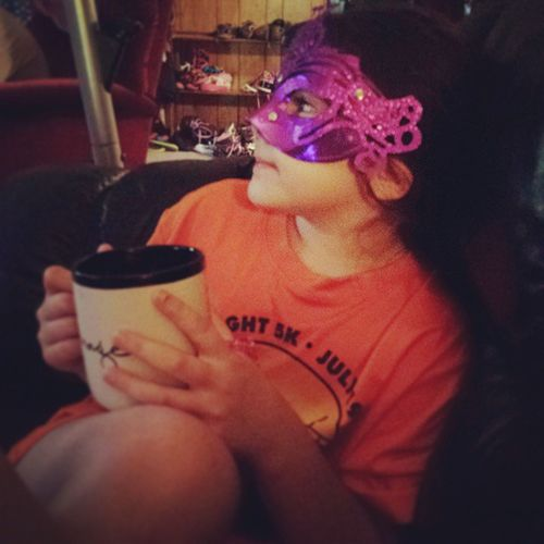 Because drinking coffee while wearing a race t-shirt and masquerade mask are part of our version of normal.