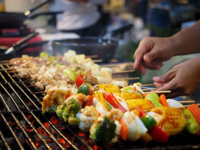 Man grilling shish kebabs