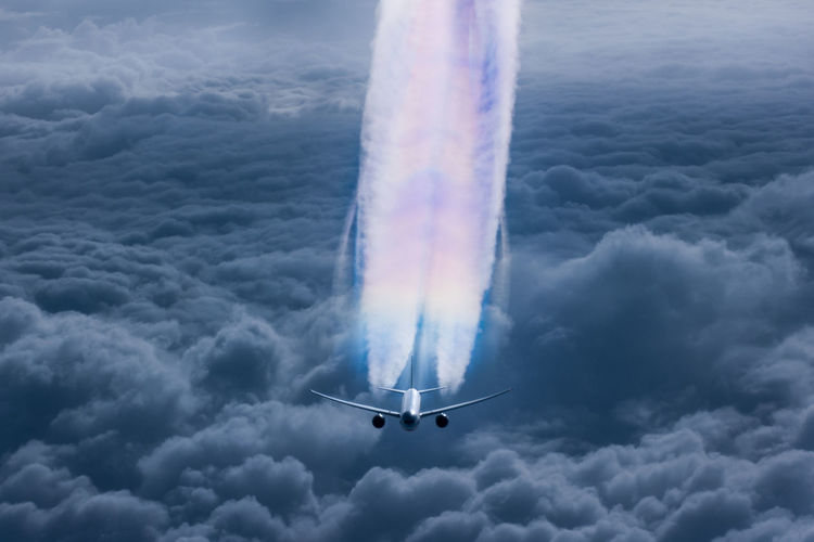 High angle view of airplane flying over cloudy sky