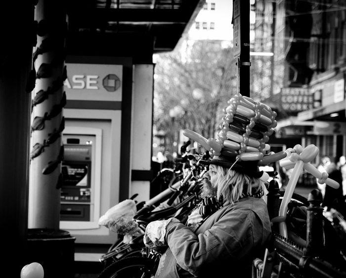 Streetphotography_bw Street Photography Pikeplacepublicmarket PikePlaceMarket Pikeplace Streetphotography Streetphoto_bw Black & White Pike Place Market Seattle Street City Walking Balloon Balloons Clown Clowns Streetperformer Street Performer