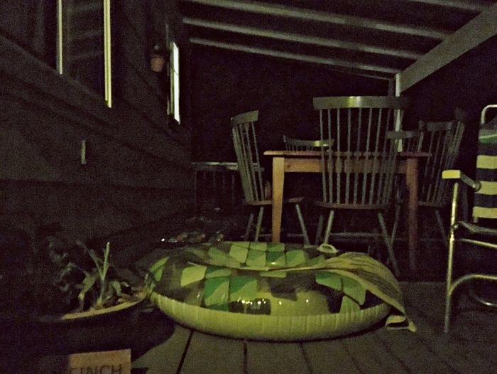 Front Porch At Night Pool Toy Lounge Chair Dining Table Chairs House Plants Night Photography Green No People Medium Group Of Objects