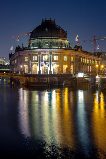 River In Front Of Illuminated Bode-Museum At Dusk
