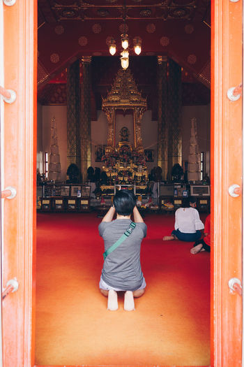 Rear View Real People Architecture Built Structure Full Length One Person Place Of Worship Women Religion Building Indoors  Lifestyles Leisure Activity Adult Sitting Belief Entrance Illuminated Spirituality Hairstyle Ornate
