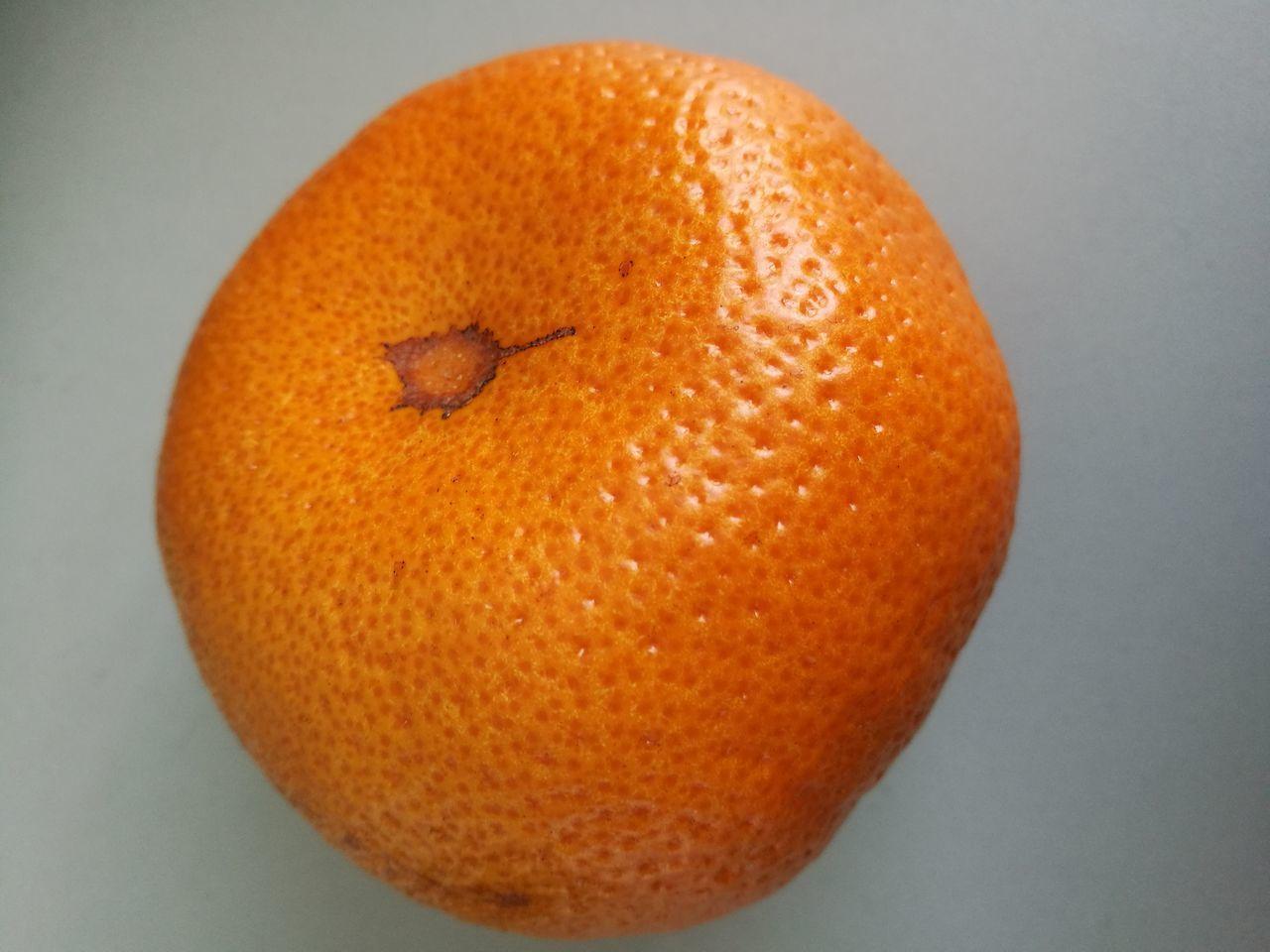 Close-Up Of Orange Fruit On White Background