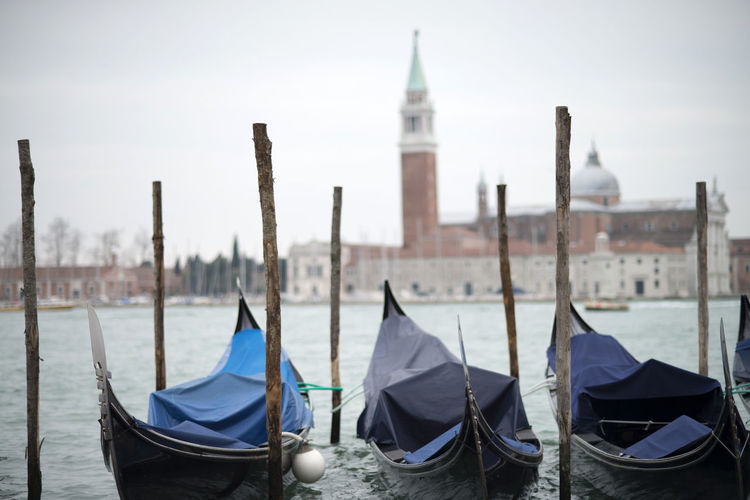 Architecture Bell Tower Bell Tower - Tower Bella Italia Building Exterior Cultures Day Gondola - Traditional Boat Iconic Moored Nautical Vessel No People Outdoors Place Of Worship San Marco Sky Travel Destinations Venice, Italy Water Wooden Post