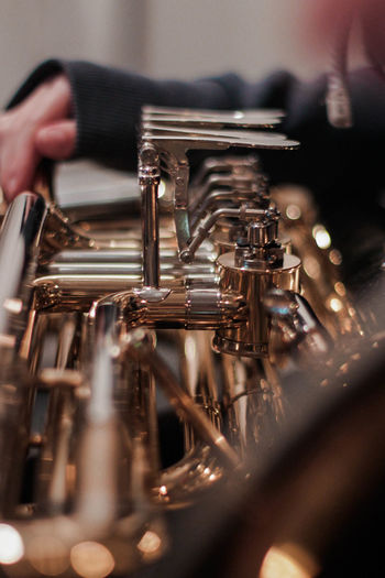 Tuba Practice Indoors  Music Arts Culture And Entertainment Holding One Person Human Hand Close-up Hand Musician Performance Performing Arts Event Bokeh Bokeh Photography Selective Focus Focus On Foreground Musical Instrument Brass Instrument  Human Body Part Trumpet Brass Artist Skill  Finger Tuba Metal Holiday Moments Analogue Sound