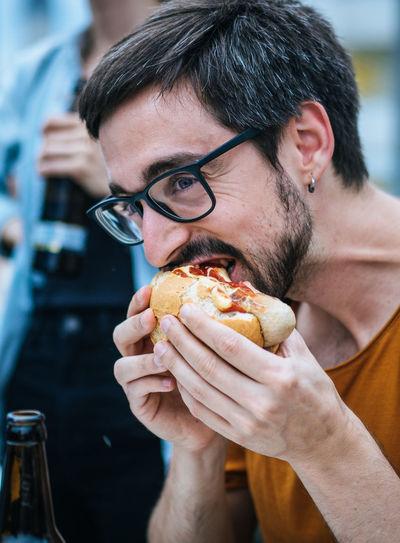 Close-up of man eating burger
