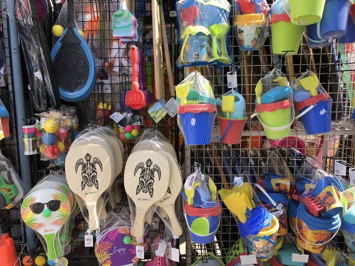Multi colored decorations for sale at market stall
