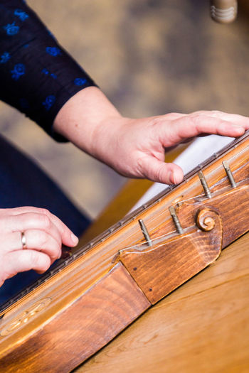 Adult Close Up Close-up Focus On Foreground Human Body Part Human Hand Instrument Instrument Maker Instruments Music Music Musical Instrument One Man Only One Person Outdoors People Play Playing Skill  Zither
