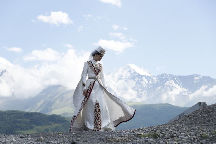 White cross on mountain against sky