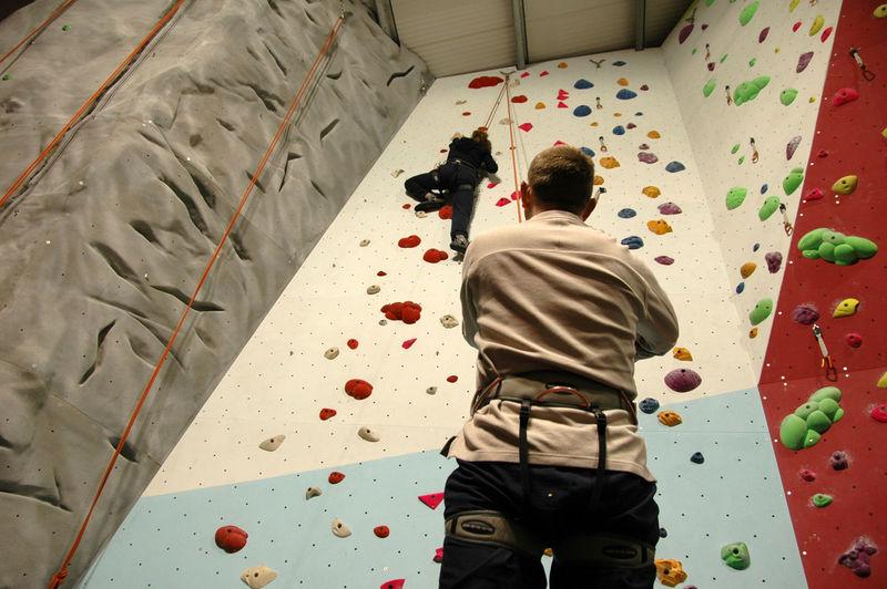 Man climbing wall at training class