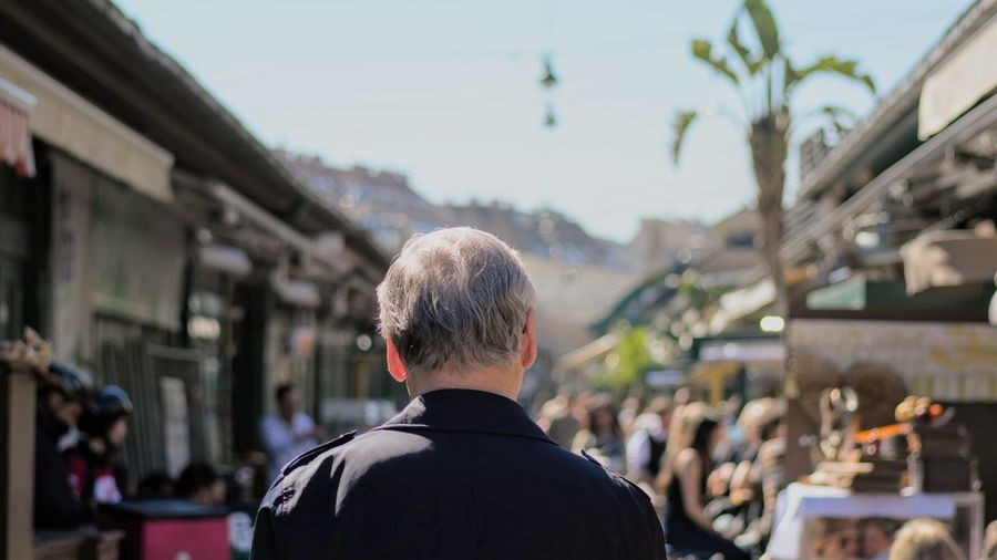 A walk in the market One Man Only Headshot Rear View Focus On Foreground Day People Outdoors Sky Men EyeEm New Here BrunomphotographyReal People Photo Market City