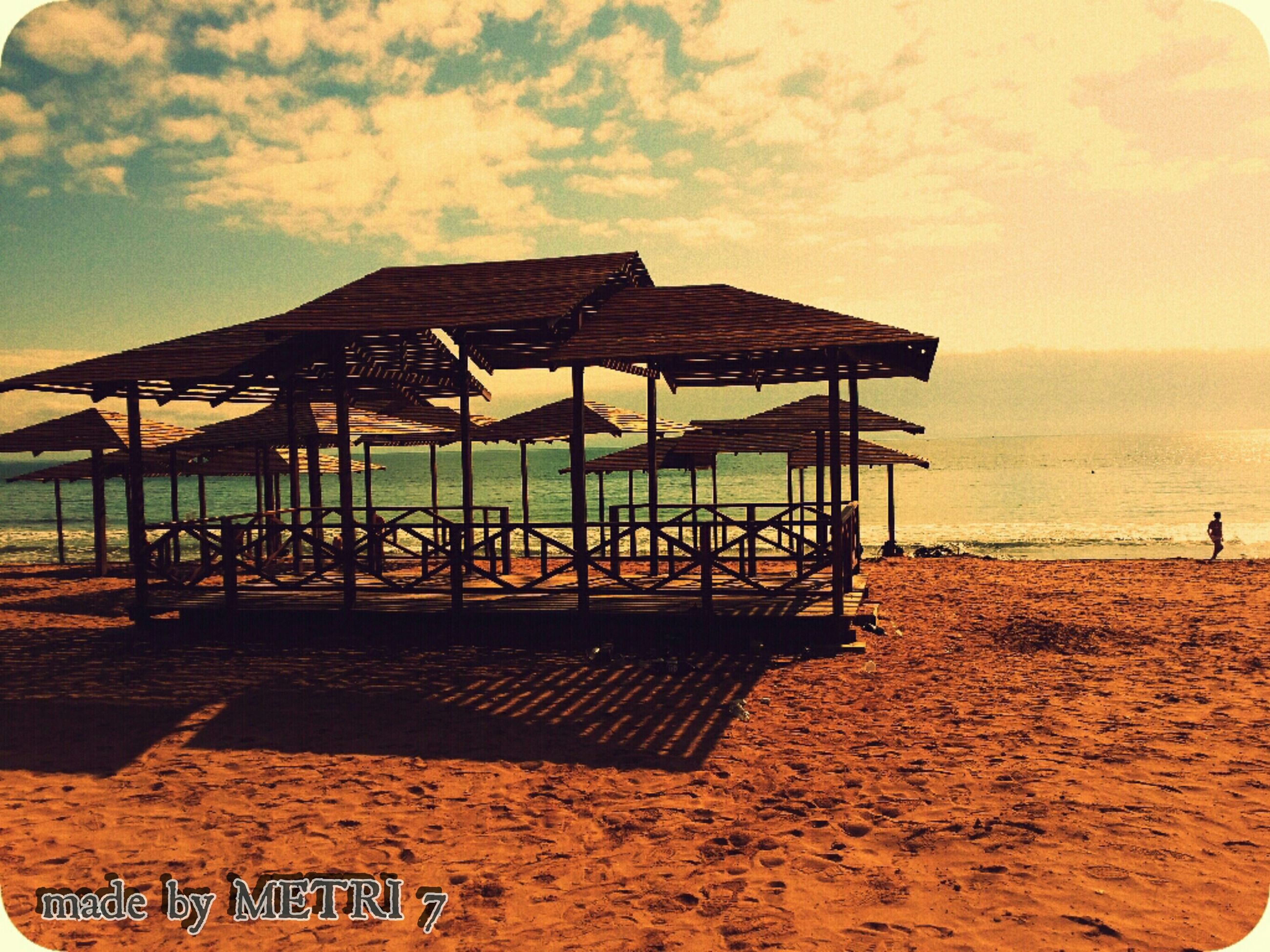 sea, beach, water, horizon over water, sky, sand, shore, tranquility, tranquil scene, scenics, sunset, beauty in nature, nature, idyllic, vacations, cloud - sky, pier, absence, outdoors, remote