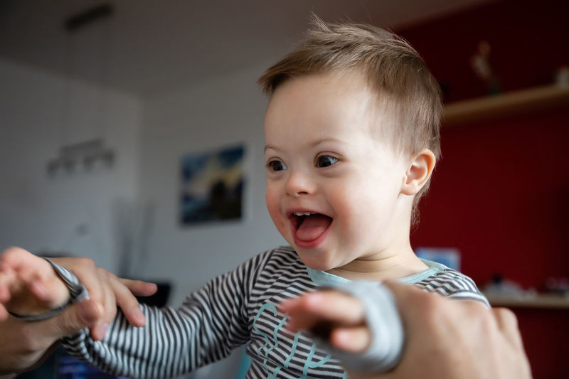 Babyboy Baby Boys Casual Clothing Child Childhood Cute Down Syndrome Emotion Happiness Headshot Indoors  Innocence Lifestyles Males  Men Mental Health  Mouth Open People Playing Portrait Real People Smiling Two People