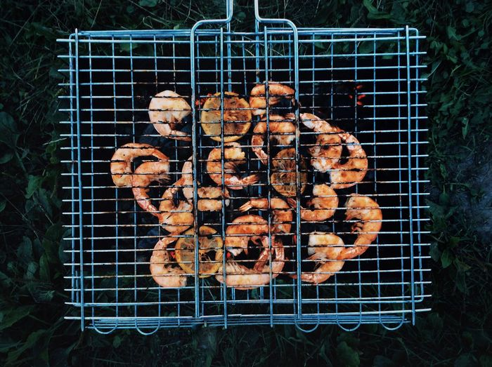 High angle view of prawns on grill
