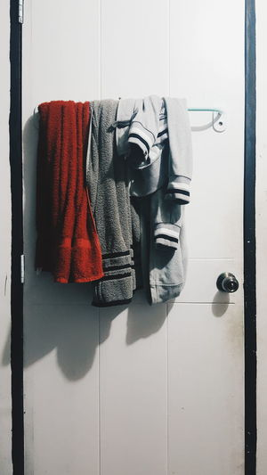 Indoors  Clothes Jacket Towel Door Hanging Red White Gray Black Still Life Hang Room