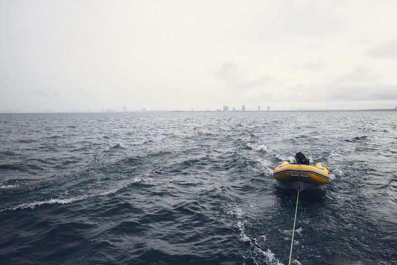 EyeEm Selects Boat Yellow Mist Morning Sea Ocean Wave Lanscape Horizon Building Sport Transportation Leisure Activity Relaxing Travel Journey Tourism Destination Marine Lifestyles Recreational Pursuit