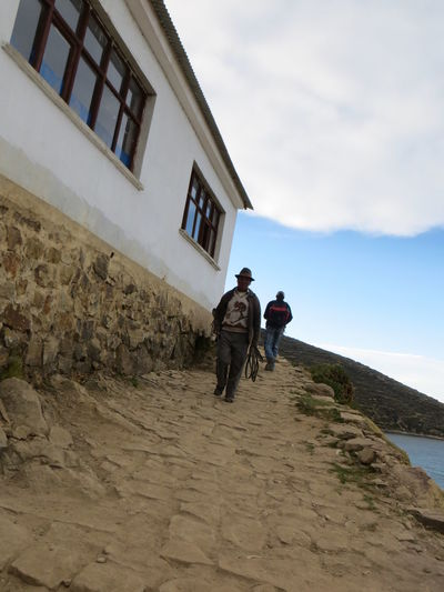 Isla Del Sol, Titicaca lake, Peru Architecture Built Structure Casual Clothing Cloud Cloud - Sky Cloudy Day Full Length Isla Del Sol Leisure Activity Lifestyles Men Native Nature Outdoors Pathway Peru Peruvian Sky The Way Forward Titicaca Tourist Destination Travel Traveling Walking