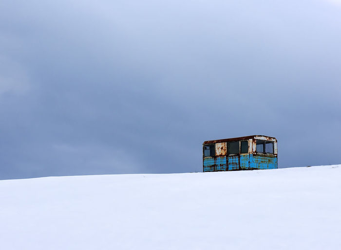 Abandoned Vehicle On Snow Covered Landscape