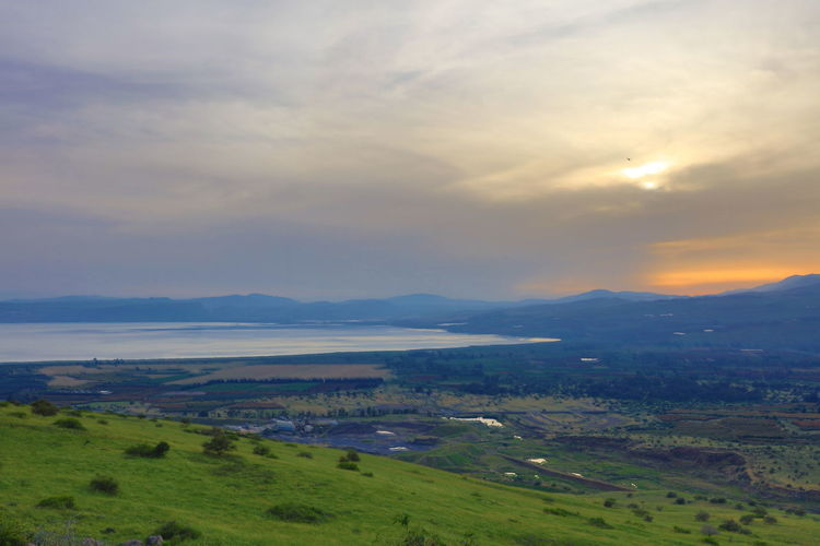Lake Genezareth, Upper Galilee, Israel photographed from the Golan Heights Christianity Cloudy Sky Dramatic Sky Golan Heights Jesus Christ Jesus Christus Romantic Landscape Tranquility Green Plain Israel Judaism Lake Genezareth Landscape Sunset Upper Galilee Wideness Sea Of Galilee Mount Carmel Mount Hermon