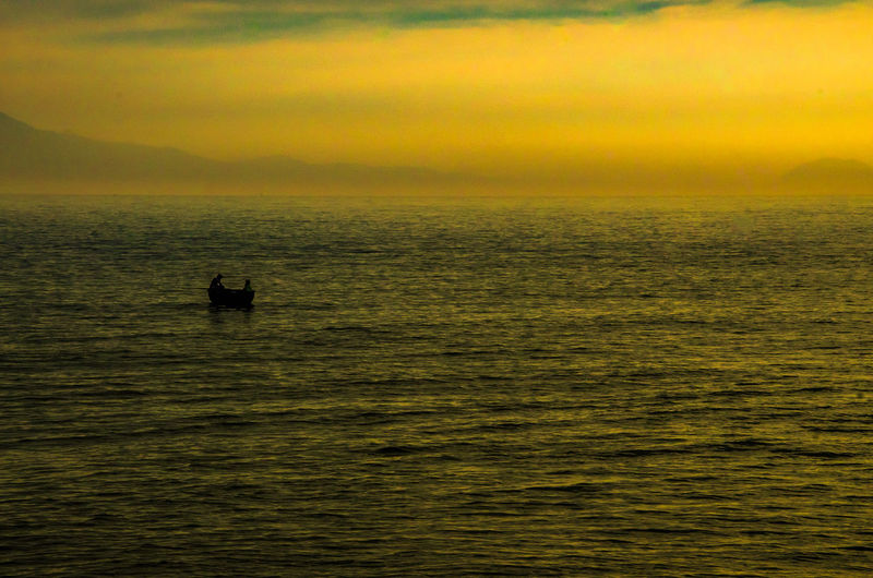 Beauty In Nature Cloud - Sky Horizon Horizon Over Water Mode Of Transportation Nature Nautical Vessel Orange Color Outdoors Scenics - Nature Sea Silhouette Sky Sunset Tranquil Scene Tranquility Transportation Water Waterfront