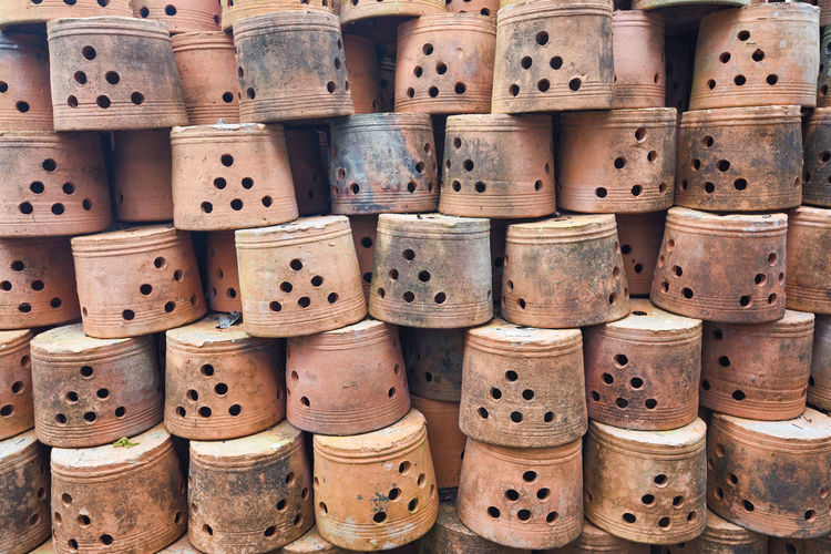 Full frame shot of stacked earthenware