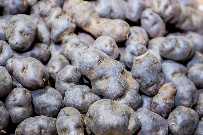 Heap of purple potatoes close up Abundance Backgrounds Close-up Day Food Food And Drink Freshness Full Frame Healthy Eating Large Group Of Objects Market No People Purple Potatoes Raw Shop Stall Vegetable