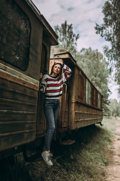 Abandoned Places Exploring Woman Abandoned Abandoned Train Casual Clothing Day Explore Front View Full Length Leisure Activity Lifestyles Looking At Camera Mode Of Transportation Nature One Person Outdoors Plant Portrait Real People Standing Train Train Station Transportation Young Adult The Traveler - 2018 EyeEm Awards The Great Outdoors - 2018 EyeEm Awards