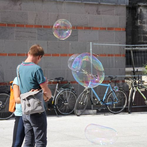 Bike Tourism Attraction Cologne Germany Streetphotography EyeEm Selects Soap Bubbles Bubble Futuristic Bubble Wand Technology Bubble Casual Clothing Rear View Couple Soap Sud Interactivity Bubble Bath Cleaning Sponge Washing Hands Shampoo Summer In The City Moments Of Happiness The Art Of Street Photography