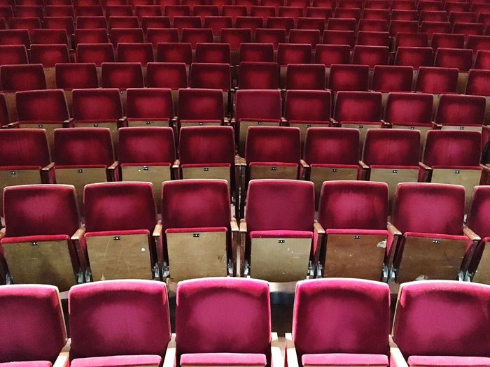 In A Row Seat Empty Chair Indoors  Repetition Full Frame No People Movie Theater Backgrounds Red Auditorium Day Film Industry Red Berliner Ensemble