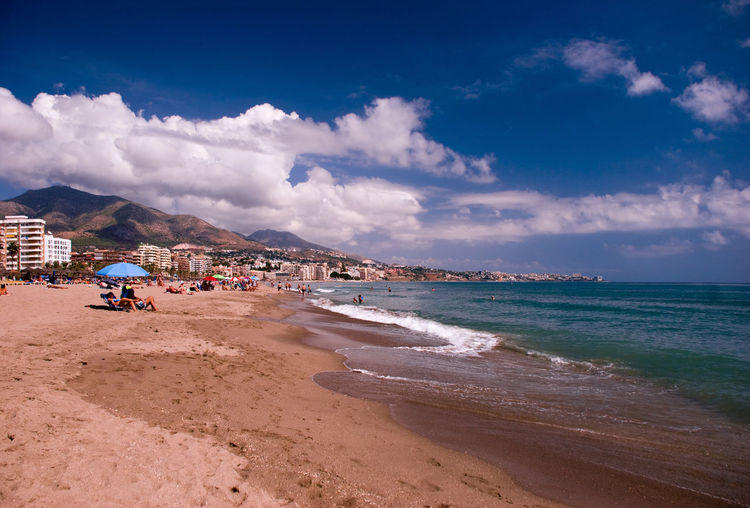 Fuengirola beach Fuengirola Spain SPAIN Architecture Beach Beauty In Nature Cloud - Sky Clouds Day Holiday Horizon Over Water Incidental People Land Nature Ocean Outdoors Real People Sand Sandy Beach Scenics - Nature Sea Sky Vacation Vacations Water Wave #FREIHEITBERLIN