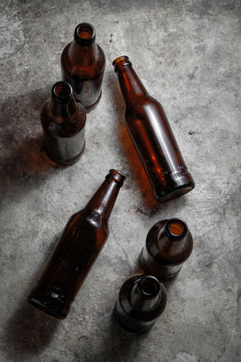 High angle view of old bottles