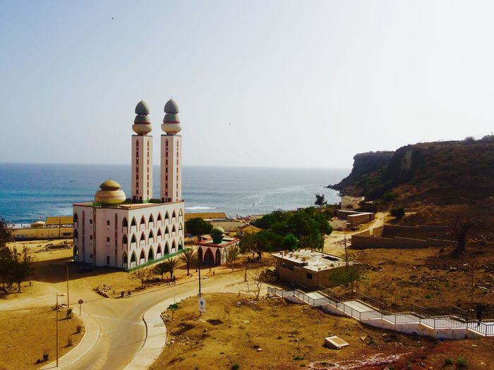 Divine mosque- Dakar, Senegal Architecture Beauty In Nature Building Exterior Built Structure Clear Sky Dakar Day Divine Mosque Horizon Over Water Mosque Mountain Nature No People Outdoors Religion Religion Architecture Scenics Sea Senegal Sky Tranquility Travel Destinations Water EyeEm Selects