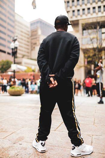 Rear view of man skateboarding on street