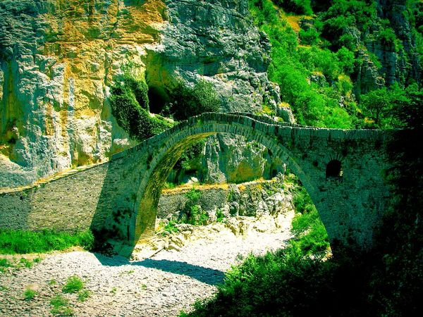 The KIOMI Collection Bridge Old Bridge Stone Bridge Creek Creek Bed Cliff Steep Cliff Seeing The Sights Trees And Bridge Trees Zagoroxoria,greece Ipiros Pebbles Share Your Adventure Nature One Arch Bridge Forest Arch Architecture Showcase April Seeing The Sites Shades Of Green  The Architect - 2016 EyeEm Awards Telling Stories Differently