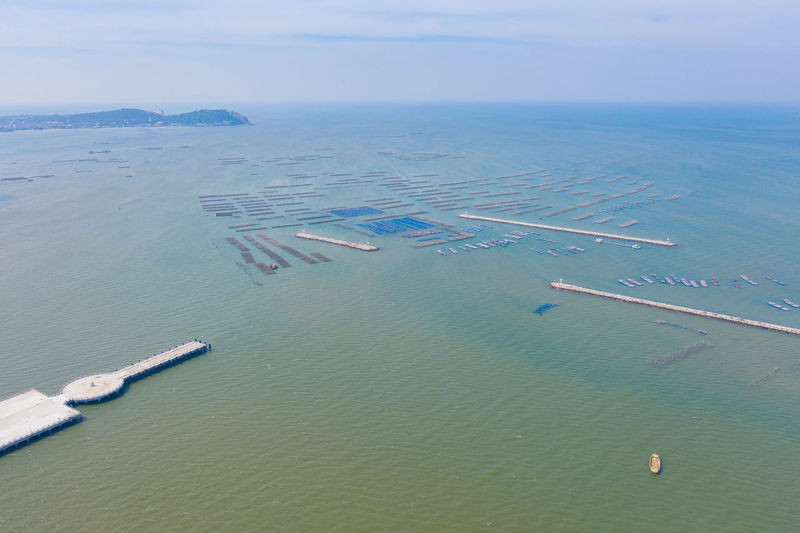 High angle view of boats in sea against sky